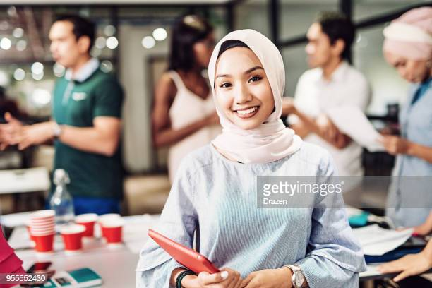 Portrait of young Asian woman involved in new business project