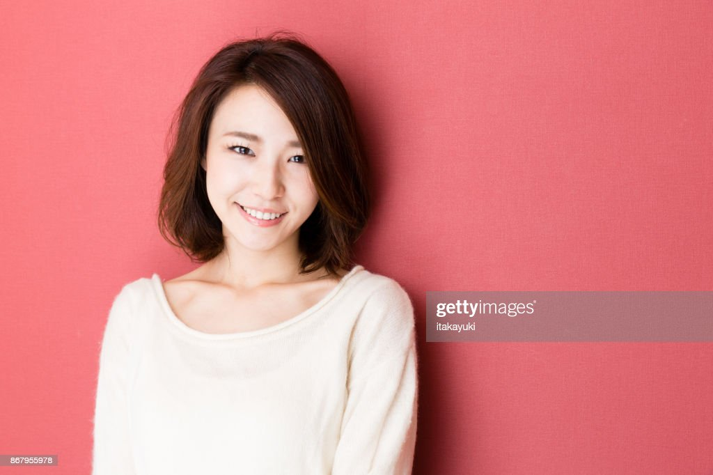 portrait of young asian woman isolated on red background : Stock Photo