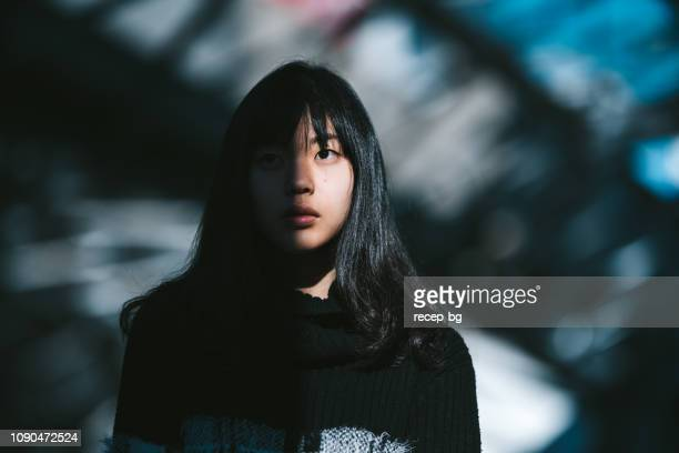 portrait of young asian woman - fear stock pictures, royalty-free photos & images