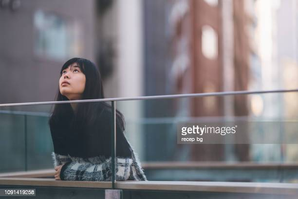 portrait of young asian woman - looking up stock pictures, royalty-free photos & images
