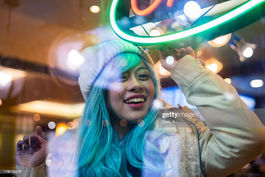 Portrait of young Asian Woman wearing a wig at night. : Stock Photo
