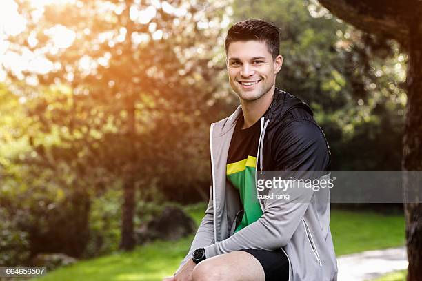 Portrait of young athlete in park
