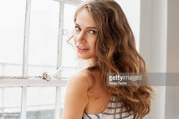 portrait of young attractive woman - wavy hair stock pictures, royalty-free photos & images
