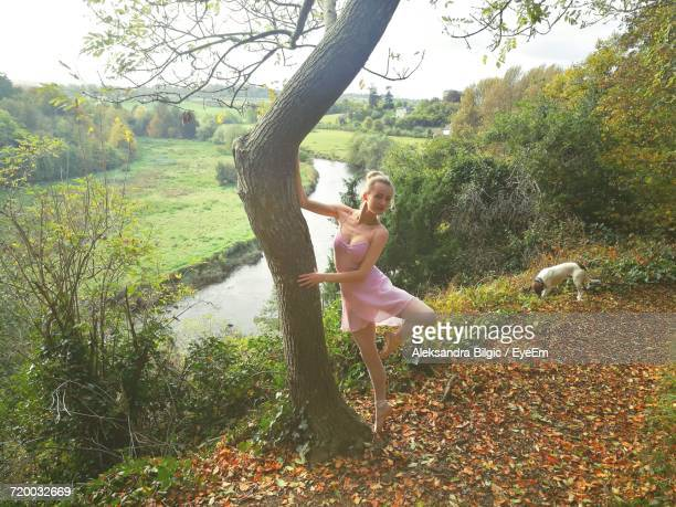 Portrait Of Young Ballerina Practicing At Park