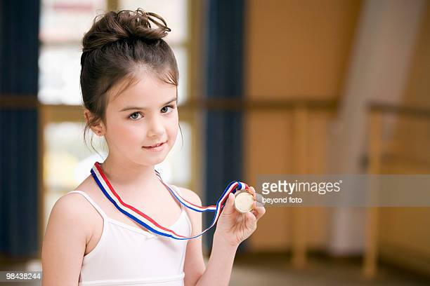 portrait of young ballet dancer holding medal - medalist stock pictures, royalty-free photos & images