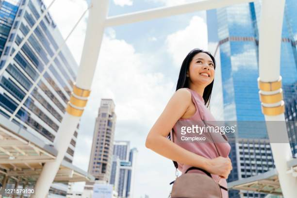 portrait of young beautiful asian businesswoman in city - pink purse stock pictures, royalty-free photos & images