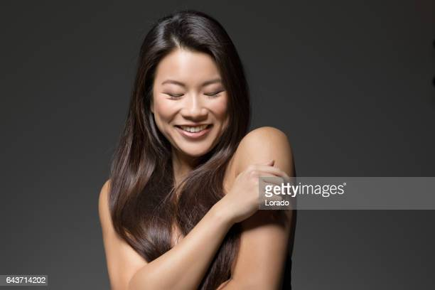 Portrait of Young Beautiful Asian Model in Studio Setting