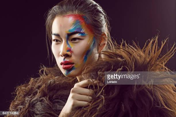 portrait of young beautiful asian model in studio setting - mongolian models stock pictures, royalty-free photos & images