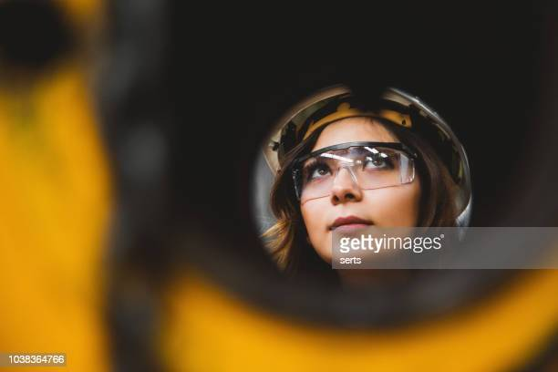 portrait of young beautiful engineer woman working in factory building. - wide angle stock pictures, royalty-free photos & images