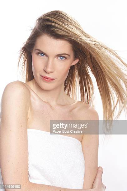 portrait of young beautiful lady with hair blowing