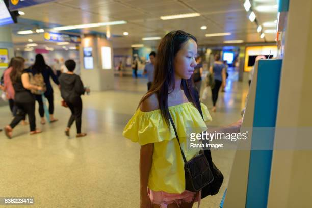 Portrait of young beautiful multi-ethnic tourist woman at the MRT subway train station in Bangkok Thailand