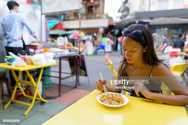 Portrait of young beautiful multi-ethnic tourist woman exploring the city of Bangkok Thailand