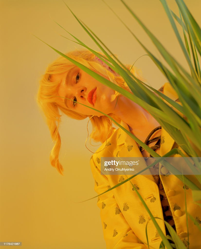 Portrait of young beautiful woman in studio : Stock Photo