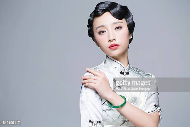 Portrait of young beautiful woman in traditional cheongsam