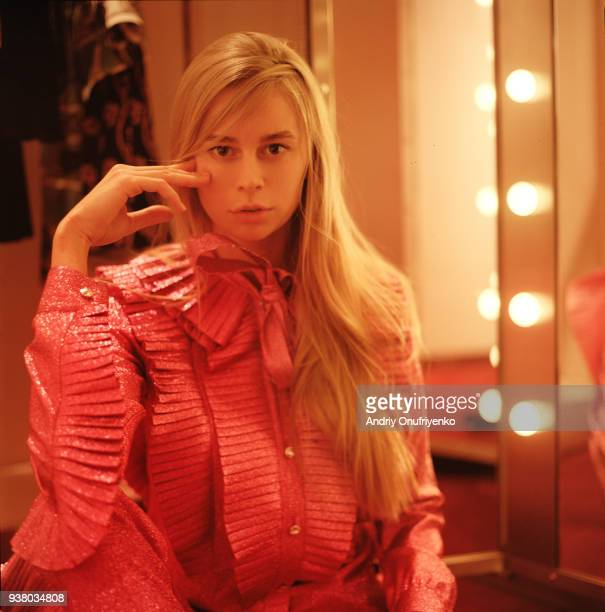 Portrait of young beautiful woman inside dressing room with mirror