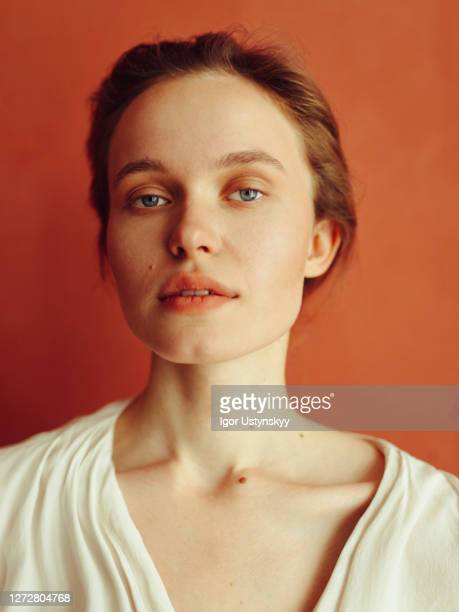 portrait of young beautiful woman looking calm - concentration stock pictures, royalty-free photos & images