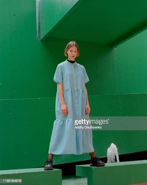 portrait of young beautiful woman - green dress stock pictures, royalty-free photos & images