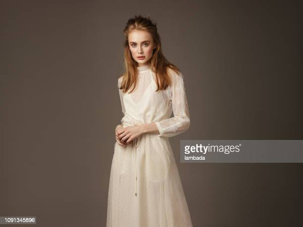 portrait of young beautiful woman wearing lace dress - beige dress stock pictures, royalty-free photos & images