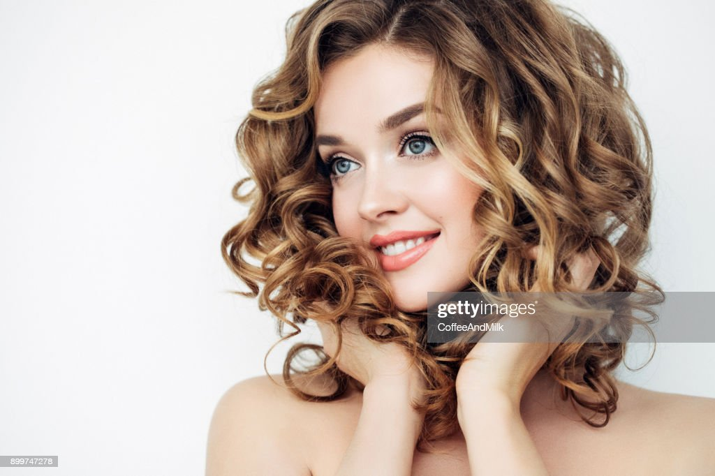 Portrait of young beautiful woman with elegant make-up and perfect hairstyle : Stock Photo