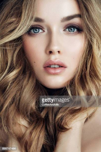 portrait of young beautiful woman with elegant make-up and perfect hairstyle - eye make up stock photos and pictures
