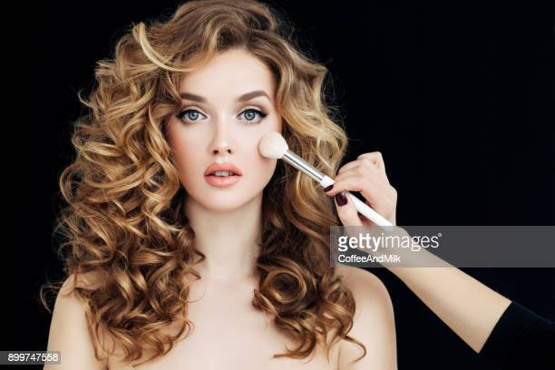 Portrait of young beautiful woman with elegant make-up and perfect hairstyle