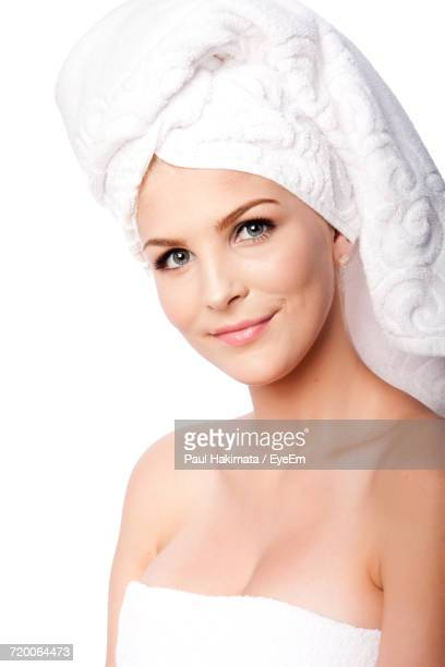 Portrait Of Young Beautiful Woman Wrapped In A Towel Against White Background