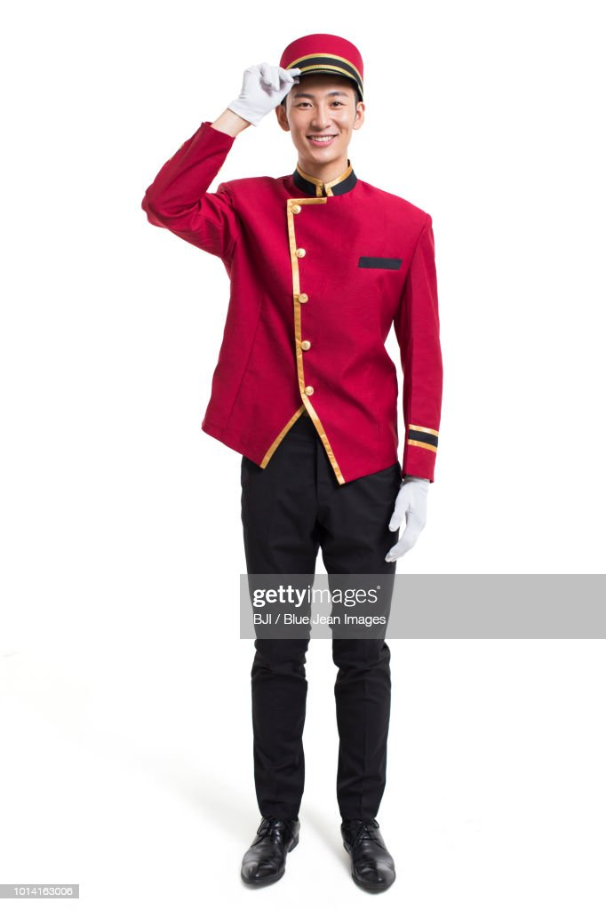 Portrait of young bellboy : Stock Photo