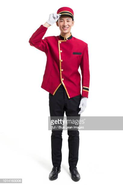 portrait of young bellboy - doorman stock photos and pictures