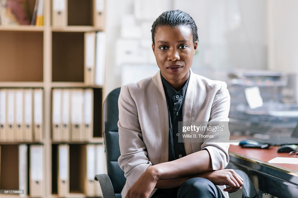 Portrait of young black fashion designer in Office : Stock Photo