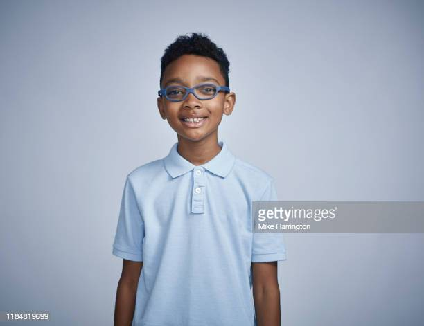 portrait of young black male - waist up stock pictures, royalty-free photos & images