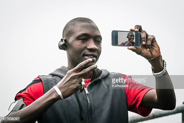 Portrait of Young black man doing selfie