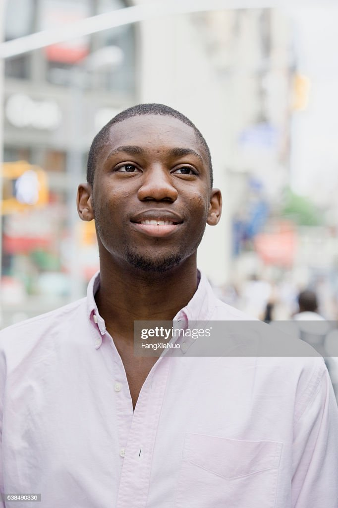 Portrait of young Black man in downtown city : Stock Photo