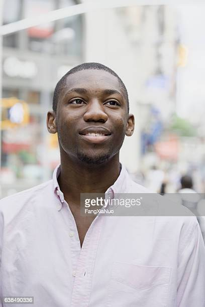 portrait of young black man in downtown city - new yorker building stock photos and pictures