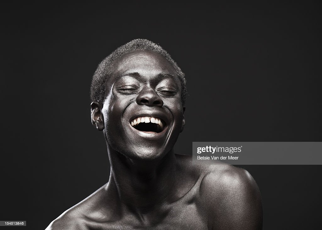 Portrait of young black man laughing. : Photo