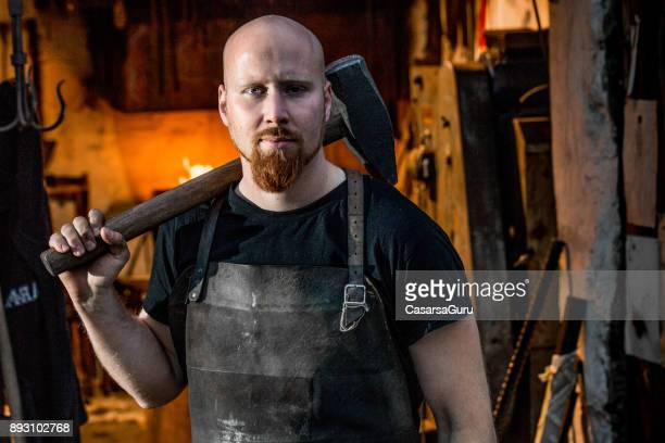 Portrait Of Young Blacksmith Holding Hammer