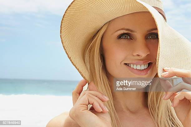 Portrait of young blonde woman on beach