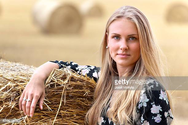 Portrait of young blonde woman on field