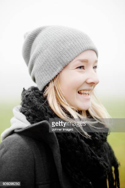 Portrait of young blonde woman standing outdoors and smiling