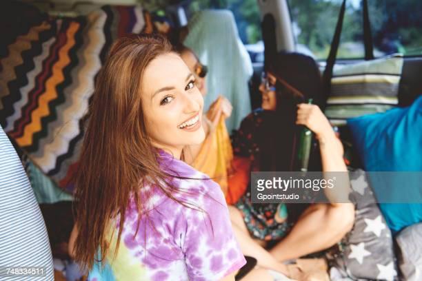 Portrait of young boho women in recreational van