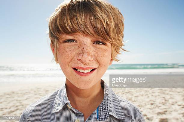 Portrait of young boy at beach
