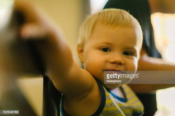 portrait of young boy at home with father - heshphoto bildbanksfoton och bilder