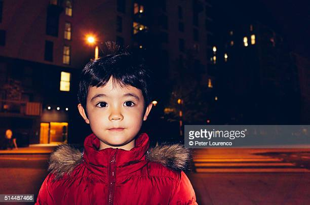 Portrait of young boy at night