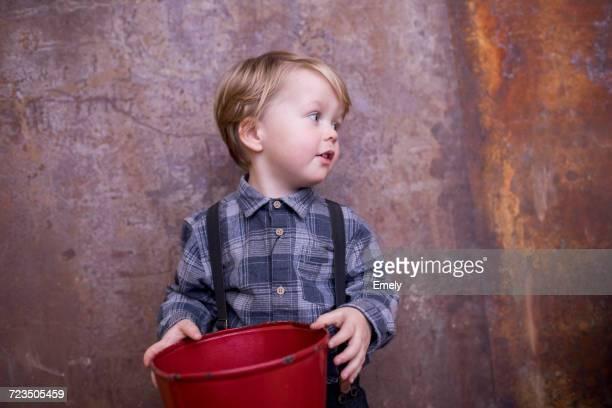 Portrait of young boy, holding megaphone
