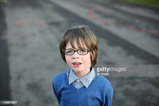 Portrait of young boy in school playground