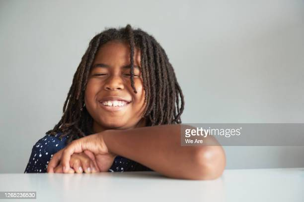 portrait of young boy laughing - one boy only stock pictures, royalty-free photos & images