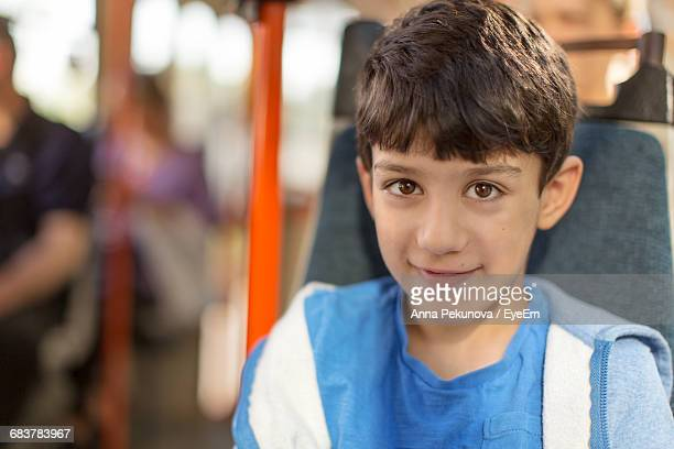 Portrait Of Young Boy On A Bus