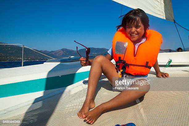 Portrait of young boy on boat wearing life jacket