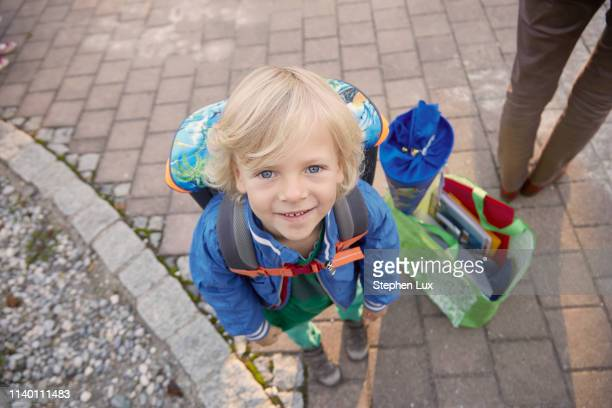 portrait of young boy on first day of school, bavaria, germany - first day of school stock pictures, royalty-free photos & images