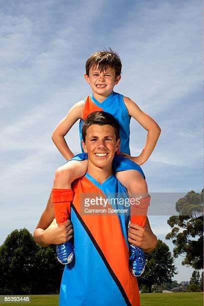 Portrait of young boy on older boy's shoulders