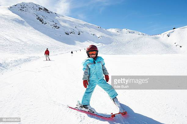 Portrait of young boy on skis